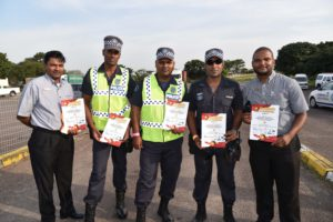 Those who attended the Brake & Tyre Watch programme were presented with certificates. Here two sales executives from Hino Pinetown, Cecil Pillay (left) and Siya Nzama (right), flank three members of the eThekwini Metro Police as they all proudly display their certificates